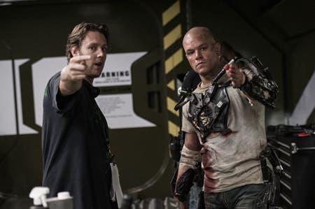 Director Neill Blomkamp (left) and Matt Damon on the set of TriStar Pictures' ELYSIUM.