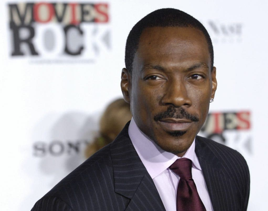 """Eddie Murphy arrives at """"Movies Rock: A Celebration of Music in Film,"""" at the Kodak Theater in Los Angeles, Sunday, Dec. 2, 2007. (AP Photo/Chris Pizzello)"""