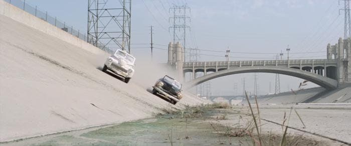 Escena carrera de coches en Grease