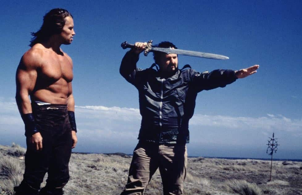 Milius on the set of Conan with Schwarzenegger